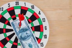Dart arrow hitting in bullseye on dartboard Stock Photos