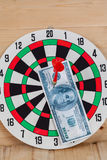Dart arrow hitting in bullseye on dartboard Royalty Free Stock Image