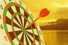 Dart arrow hitting in bullseye on dartboard royalty free stock photos