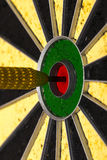 Dart arrow hitting in the target center Royalty Free Stock Photo