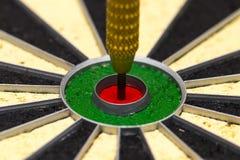 Dart arrow hitting in the target center Stock Image