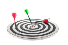 Dart arrow hitting in the target center of dartboard Stock Image