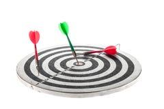 Dart arrow hitting in the target center of dartboard Stock Image