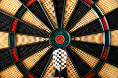 Dart arrow hitting in the target on dartboard Stock Images