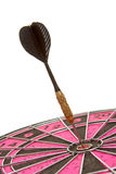 Dart arrow right in the center of a dartboard Stock Photography