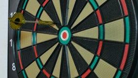 A dart arrow stick on the dart board. stock video
