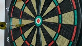 A dart arrow stick on the dart board. stock footage