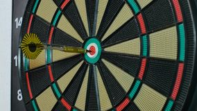 A dart arrow stick on the center of dart board. bull eye stock video footage