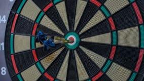 A dart arrow stick on the center of dart board. bull eye stock video