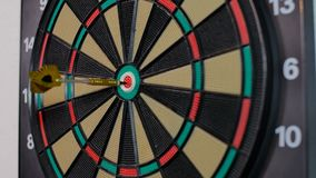 A dart arrow stick on the center of dart board. bull eye stock footage