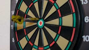 A dart arrow stick on the dart board. stock footage