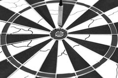 Dart arrow on a target board Royalty Free Stock Images