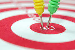 Dart arrows hitting in the target Stock Photos