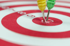Dart arrows hitting in the target Stock Images