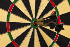 Dart arrows hitting in the target center Stock Photography