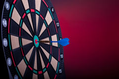 Dart board. Close up of an electronic dart board and blue arrow Stock Photography