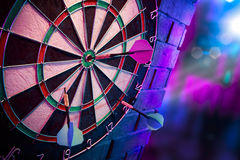 Dart board on a brick wall with dramatic lighting Royalty Free Stock Photo