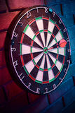 Dart board on a brick wall with dramatic lighting Royalty Free Stock Image
