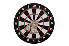 Dart board with centered arrows and banknotes Stock Photography