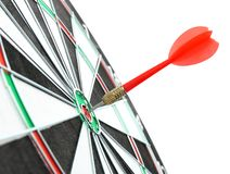 Dart board with color arrow hitting target. Closeup royalty free stock images