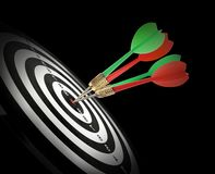 Dart board with color arrows hitting target on black. Background royalty free stock photography