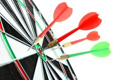 Dart board with color arrows hitting target on white background. Closeup royalty free stock images