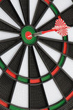 Dart board with dart Stock Photography