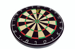 Dart board with a dart in the middle. Isolated dart board heaving a dart in bulls-eye Stock Image