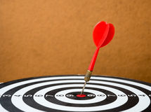 Dart board with darts arrow in the target center. (Success business concept Stock Image