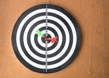 Dart board with darts arrow in the target center. (Success business concept Royalty Free Stock Photo