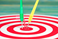 Dart board with darts Royalty Free Stock Images