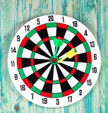 Dart board with darts on background Royalty Free Stock Photos