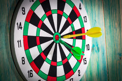Dart board with darts on background Royalty Free Stock Images