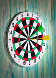 Dart board with darts on background Stock Image