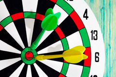 Dart board with darts on background Royalty Free Stock Image