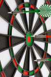 Dart board with darts Royalty Free Stock Image