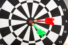 Dart board with darts, selective focus on board Stock Images