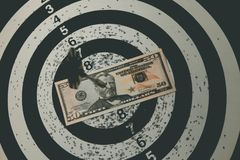 Dart board with darts on target with your money. stock image
