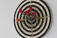 Dart board with hanging on the wall. Dart board with darts hanging on the wall Royalty Free Stock Images