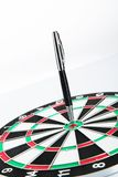 Dart board with pen on white background Stock Image