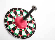 Dart board with plunger on white background Royalty Free Stock Images