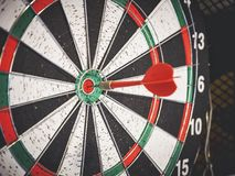 Dart board with red arrow hit center Target Goal concept. Dart board with red arrow hit center Target Goal success conceptual Stock Image