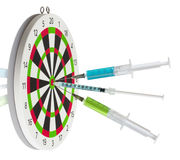 Dart board and syringes Royalty Free Stock Image