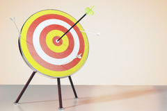 Dart board on the table and a direct hit on target. Close up Stock Photos
