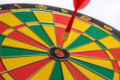 Dart board targeting the center on a white background Royalty Free Stock Photo