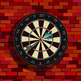 Dart board on a wall. Realistic dart board on a brick wall, graphic art Royalty Free Stock Photo