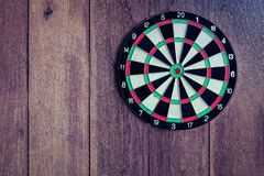 Dart board on wooden old wall High Dynamic Range tone. Dart board on wooden old wall High Dynamic Range tone and soft retro filter tone royalty free stock photo