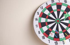 Dart borad hang on the wall and red dart. Right on target concept using dart in the bullseye on dartboard business success concept stock photography