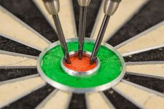 Dart in bull& x27;s eye, close up. Dart in bull& x27;s eye, close up green and red Stock Images