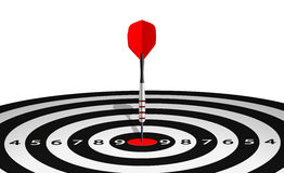 Dart in bull's eye of lined dartboard Stock Images
